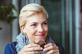 Smiling blonde enjoying a muffin cake