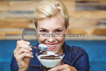 Smiling blonde holding a chocolate goblet