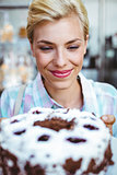 Pretty woman looking at a chocolate cake