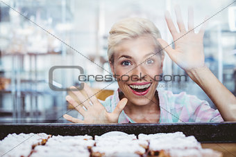 Astonished pretty woman looking at cup cakes