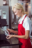 Pretty barista using the coffee machine