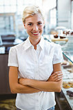 Selfassured female waitress smiling