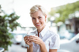Pretty blonde having cup of coffee