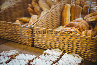 Close up of basket with fresh bread and pastry