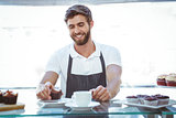 Smiling worker prepares breakfast