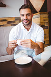Young man drinking cup of coffee