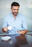 Smiling businessman using a tablet