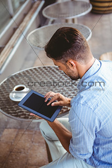 Attentive businessman using a tablet