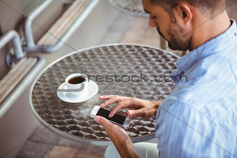 Attentive businessman sending text message
