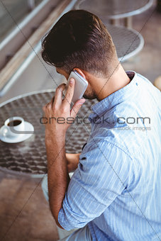 Attentive businessman on the phone