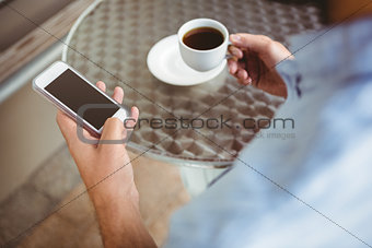 Close up view of businessman texting