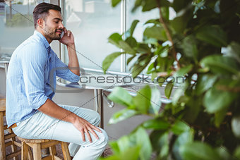 Smiling businessman on the phone