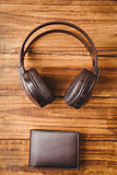 Music headphone next to wallet