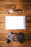 Tablet next to joystick and glasses
