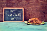roast turkey and chalkboard with the text happy thanksgiving day