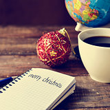 bauble, cup of coffee, globe and text merry christmas