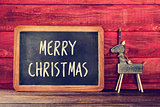 reindeer and text merry christmas in a chalkboard