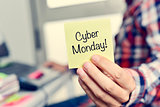 young man with a sticky note with the text cyber monday