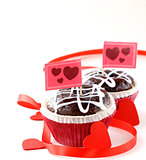 Festive pastry for Valentine's Day, chocolate muffin with red hearts