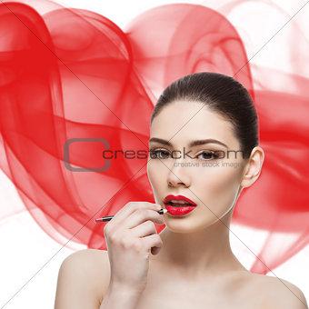 Beautiful girl with lip pencil
