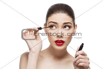 Beautiful girl with mascara tube