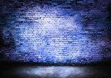 Murky brick wall in blue