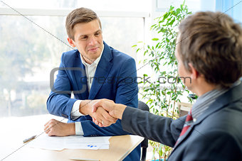 Business People Shaking Hands after Signing Contract. Business Partnership Concept