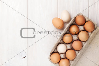 Cardboard egg box on wooden table