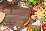 Pasta cooking ingredients and utensils on wooden table