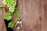 Bunch of grapes, red wine bottle and corkscrew