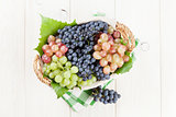 Bunch of red, purple and white grapes in basket
