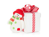 Christmas gift box and snowman toy