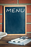 menu blackboard before brick wall