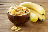 banana chips, dried fruit on a wooden table