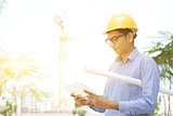 Male contractor engineer reading on tablet pc