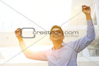 Asian Indian businessman arms up