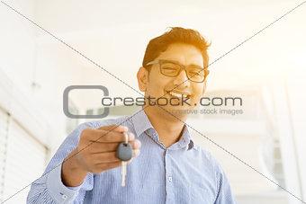 Man hand holding new key