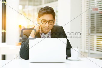 Business people using laptop computer at cafeteria