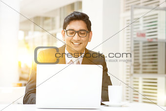 Business people using laptop pc at cafe