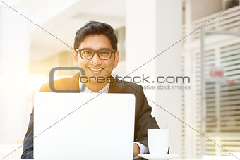 Business man using laptop computer at cafe