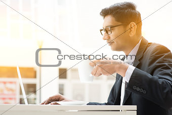 Business man using internet at cafe