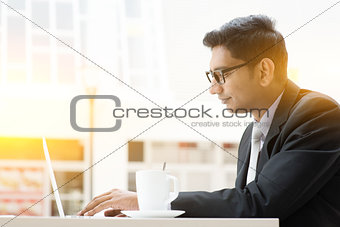 Business man browsing internet at cafe
