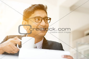 Business man using tablet pc at cafe