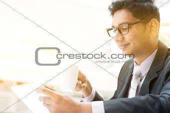Business people using tablet pc at cafe