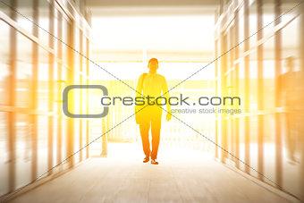 Business people walking thru modern office