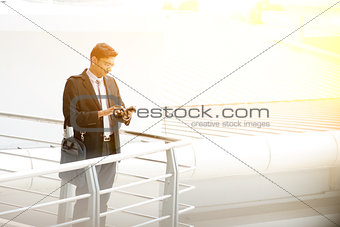 Business people using smartphone at outdoor