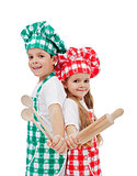 Happy chefs with wooden utensils