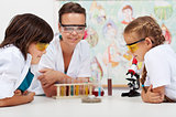 Young students watching an experiment in elementary science clas