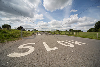 SLOW, UK road marking