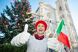 Woman with Italian flag spending christmastime in Florence